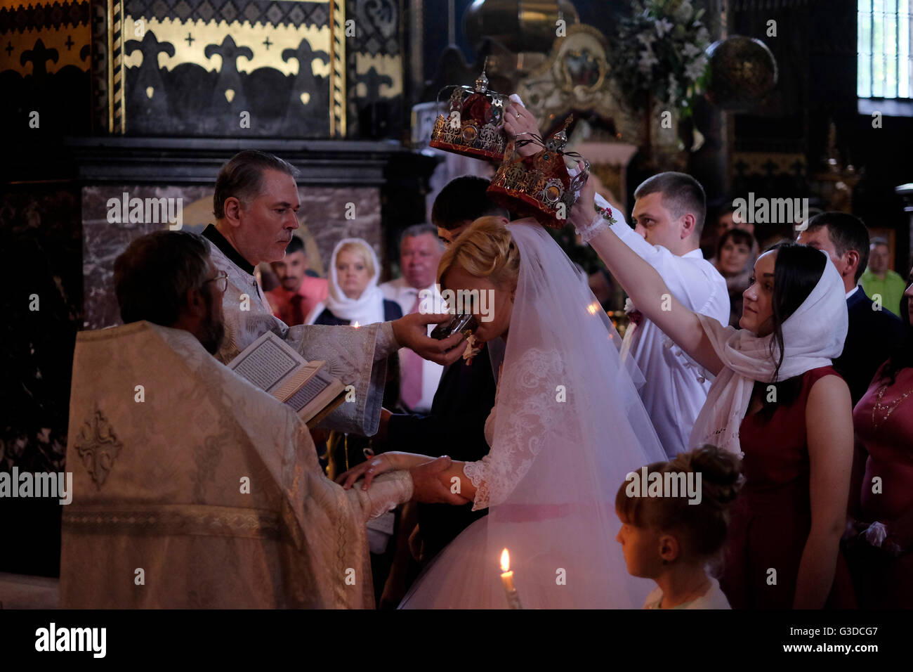 An Ukrainian Groom And Bride Are Crowned During Traditional Crowning Ceremony Of Eastern Orthodox Church Wedding Inside St Volodymyrs Cathedral In The