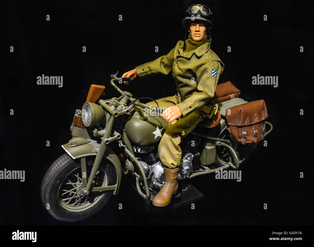 g i joe action man doll wears u s 3rd army uniform riding a harley stock photo royalty free. Black Bedroom Furniture Sets. Home Design Ideas