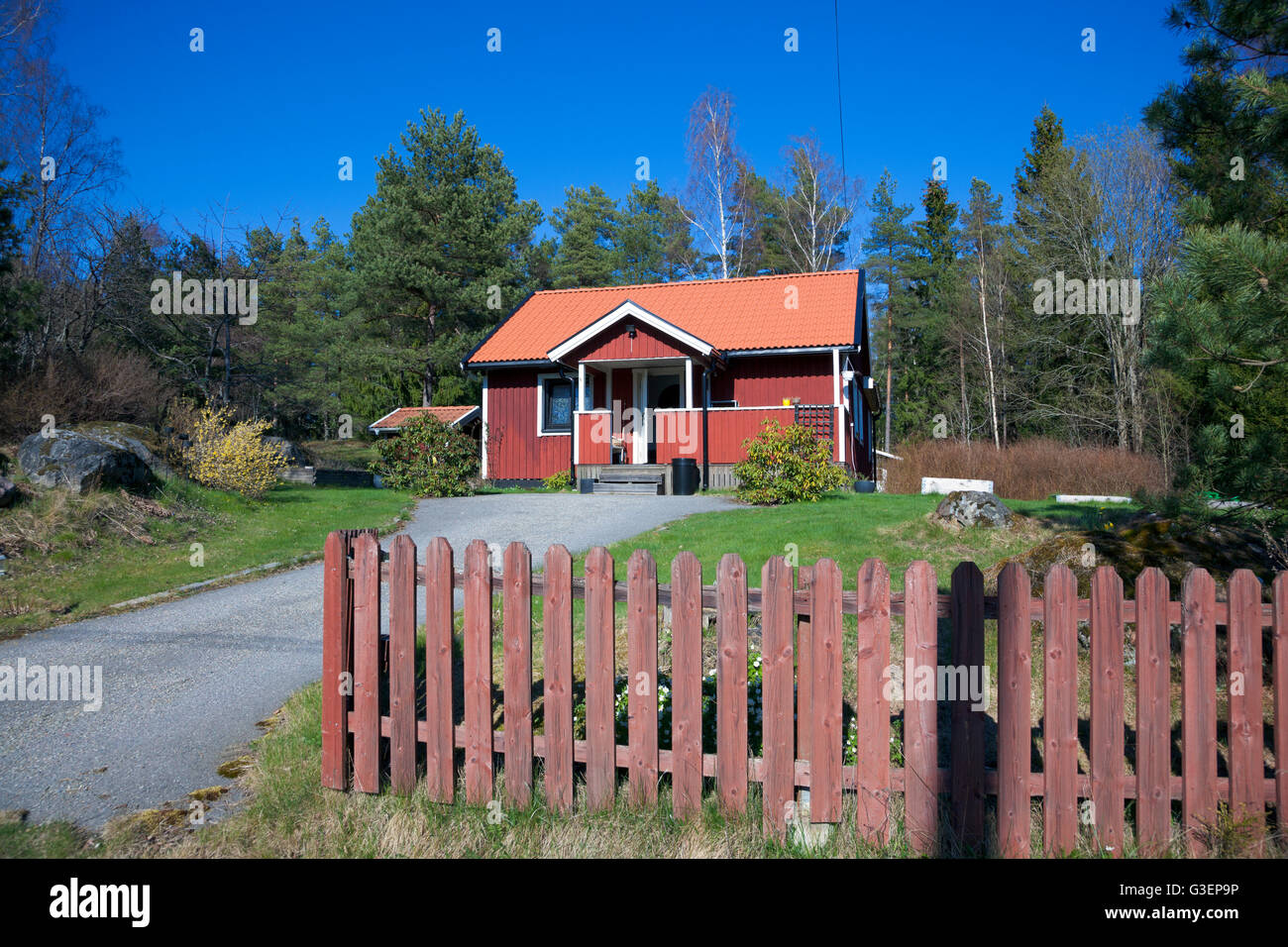 Swedish Style House red painted swedish style house in the countryside stock photo