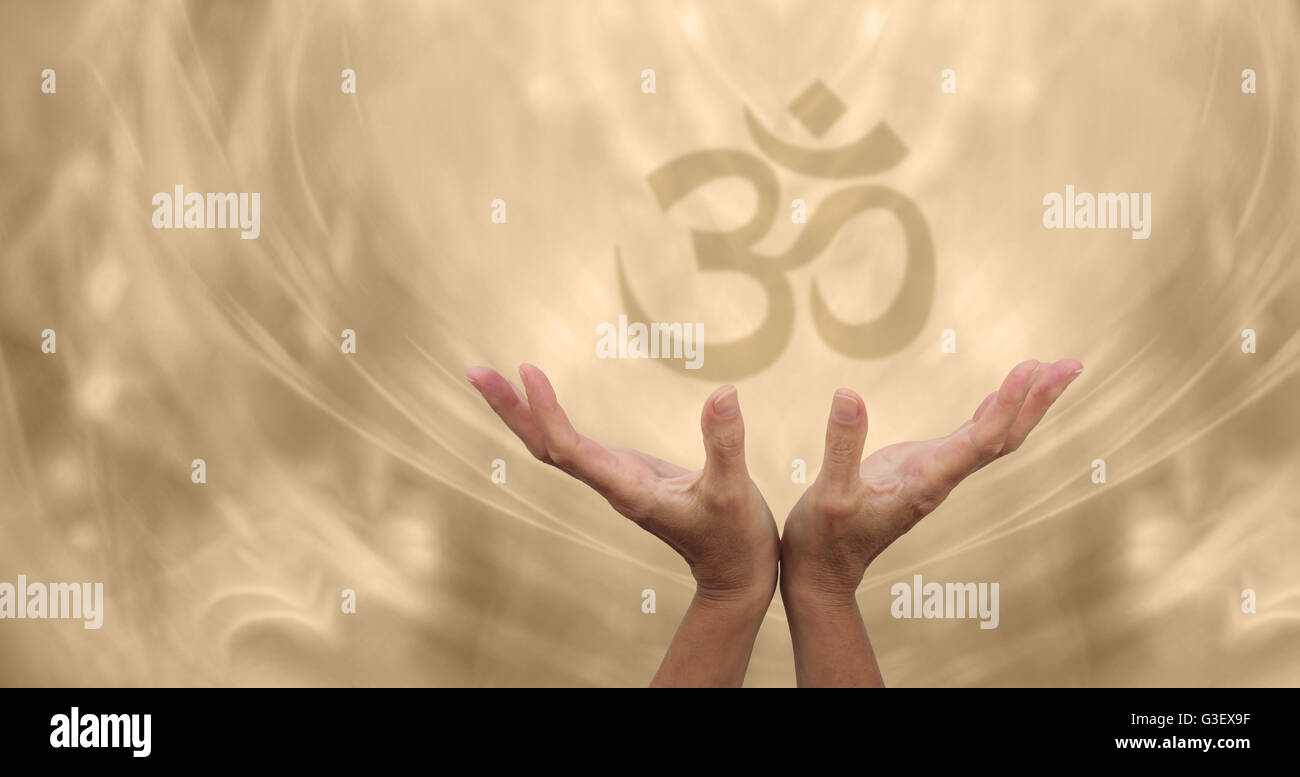 Female healing hands reaching up towards a soft focus om symbol on a female healing hands reaching up towards a soft focus om symbol on a pale golden energy formation background buycottarizona Image collections