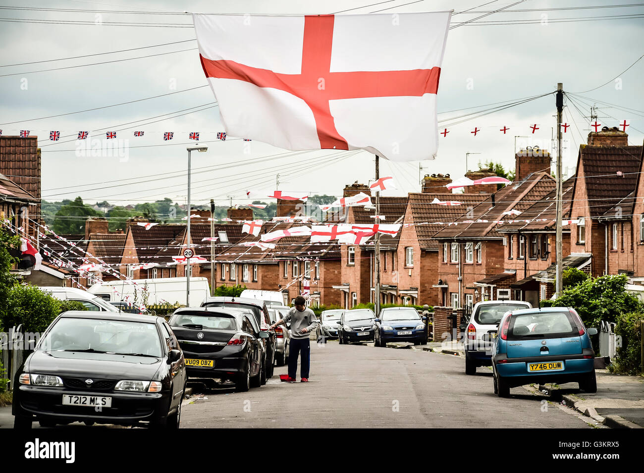 england flags are strung across torrington avenue in the knowle