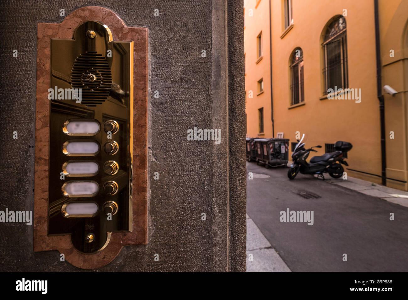 Apartment Building Front Door highly polished shiny brass doorbell intercom at front door of
