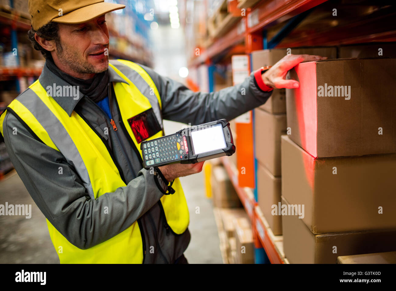 Warehouse worker using hand scanner stock photo royalty free stock photo warehouse worker using hand scanner sciox Choice Image