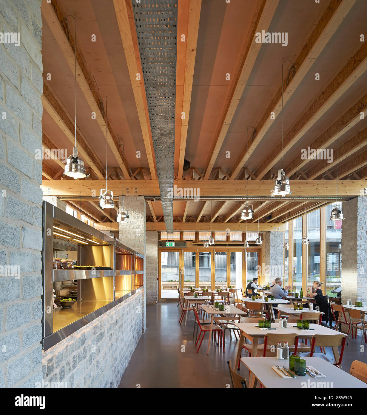 Restaurant Interior With Open Plan Kitchen Counter. The