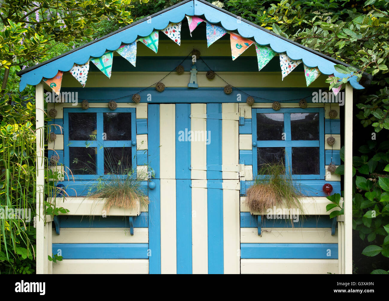 Striped Blue And Cream Painted Summer House In A Cottage
