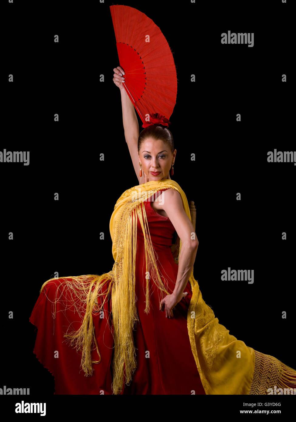 spanish woman flamenco dancing looking at the camera stock photo