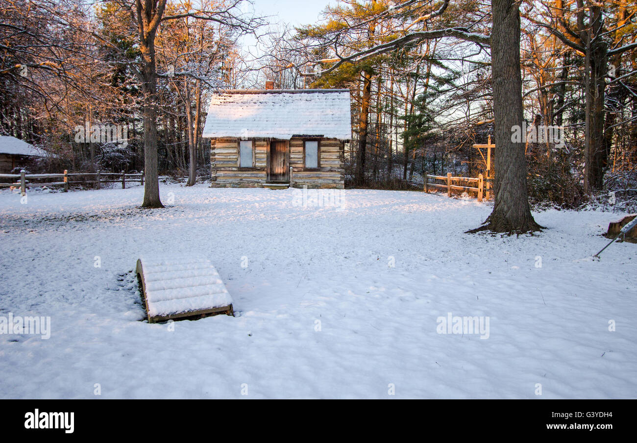 Log cabin in the woods winter - Stock Photo Winter Cabin In The Woods Snow Covered Cozy Log Cabin In A Wintry Northern Forest