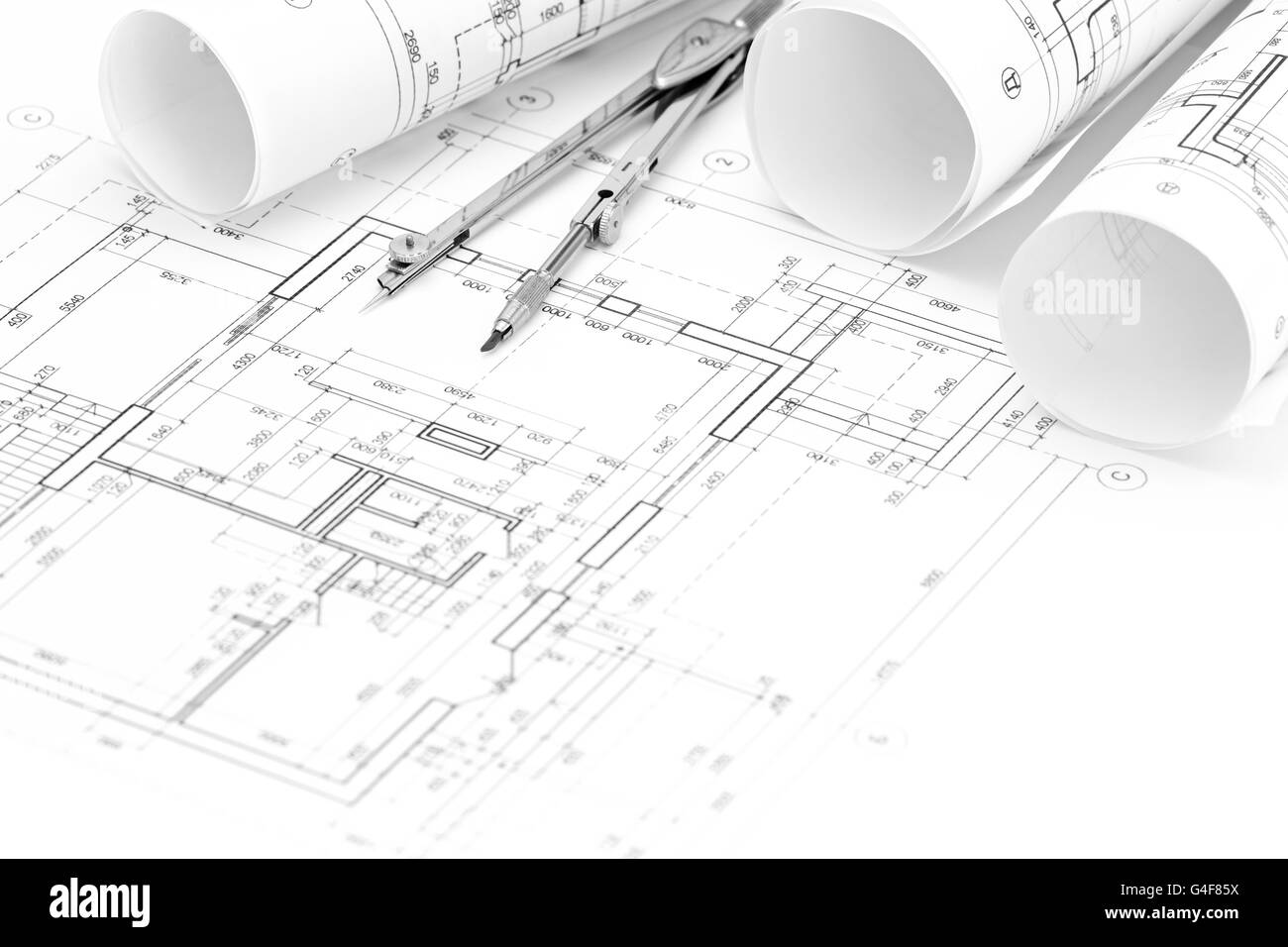 Rolls of architectural blueprints and floor plan with for Blueprint drawing program