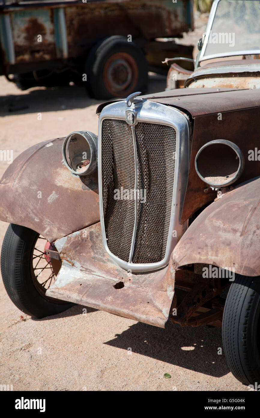 Old cars in grounds and garden of solitaire settlement in namibia stock image