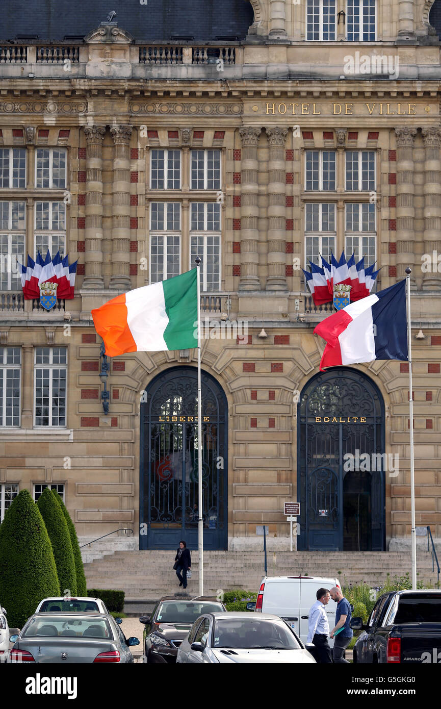 the irish flag flies alongside the french and european flags
