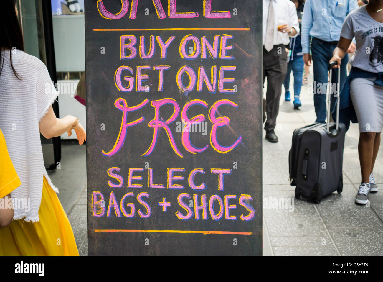 a buy one get one promotion advertised outside of a clothing a buy one get one promotion advertised outside of a clothing store in new york on friday 17 2016 © richard b levine