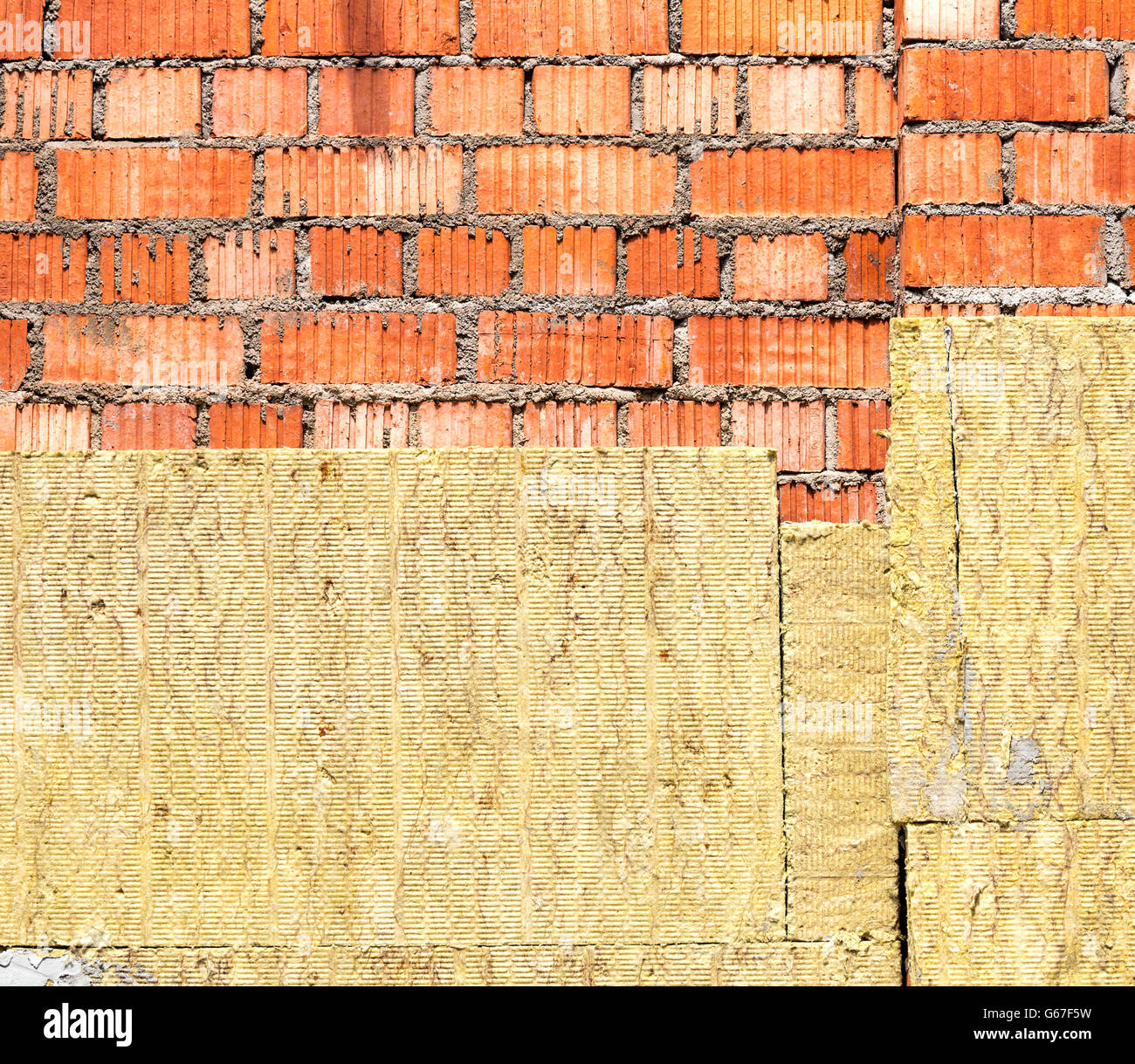 Thermal Insulation House Energy Efficiency Concept Isolated On White - Thermal insulation of a red brick house wall stock image
