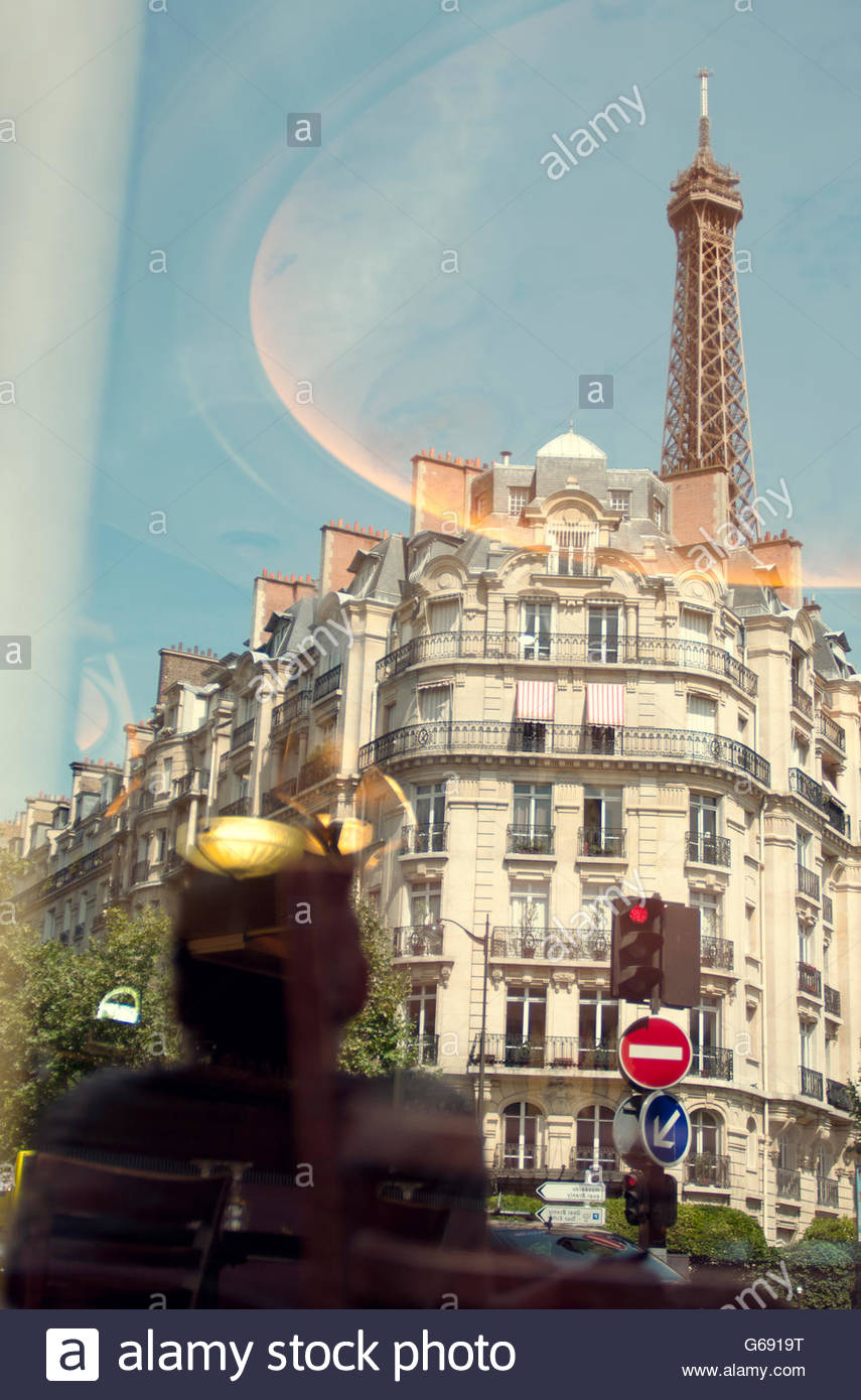 Outdoor cafe in paris with tower in background - Reflection In Cafe Window Of Paris Apartments And Eiffel Tower Stock Image