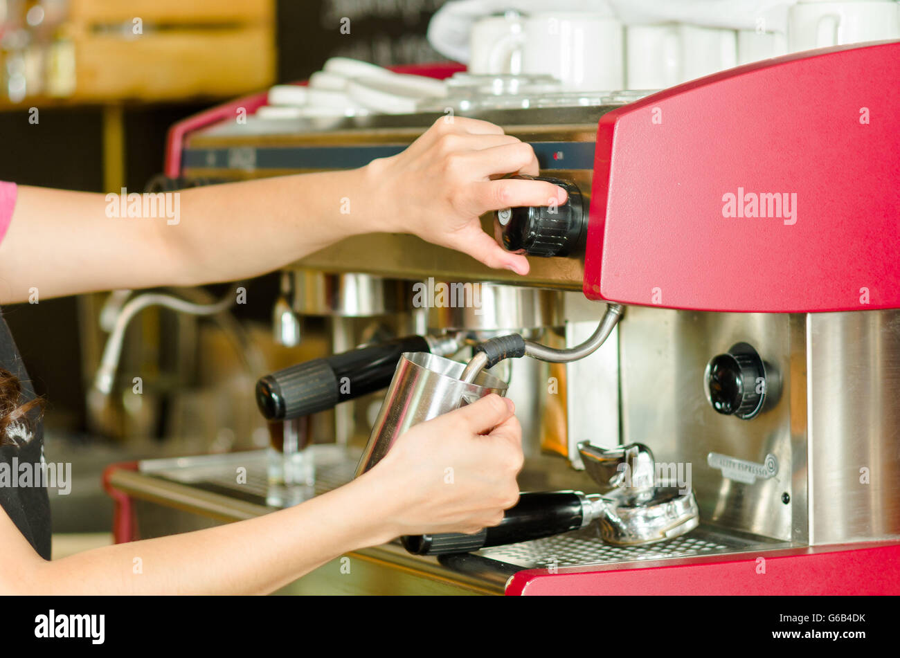 female hands working operating industrial coffee maker steaming milk in metal container - Industrial Coffee Maker