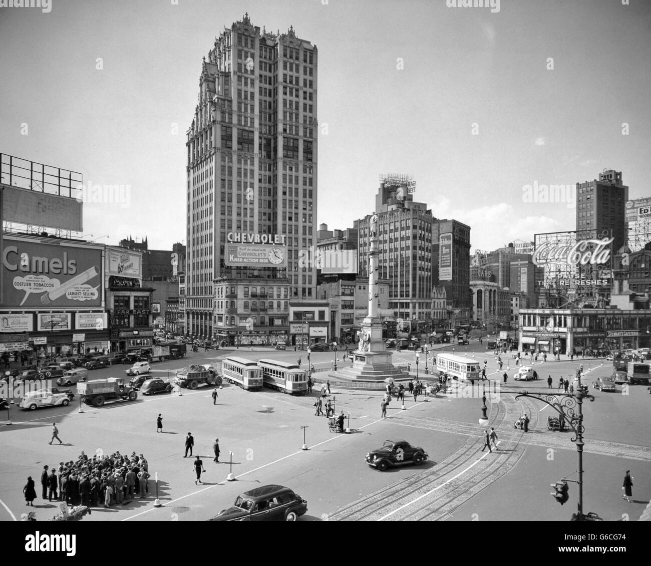 1930s COLUMBUS CIRCLE WITH COCA COLA SIGN AND TROLLEY CARS
