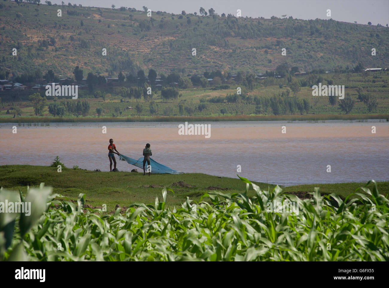 Children fishing with nets in lake alemaya a seasonal for Nearest fishing lake