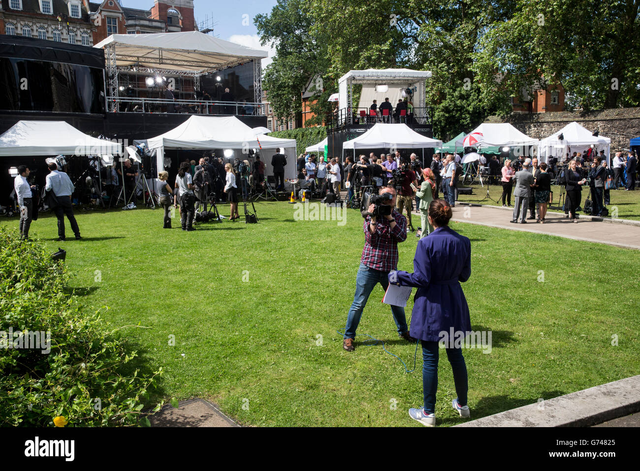 Media tents and people giving interviews on College GreenWestminster the day after the vote to leave the EU & Media tents and people giving interviews on College Green ...