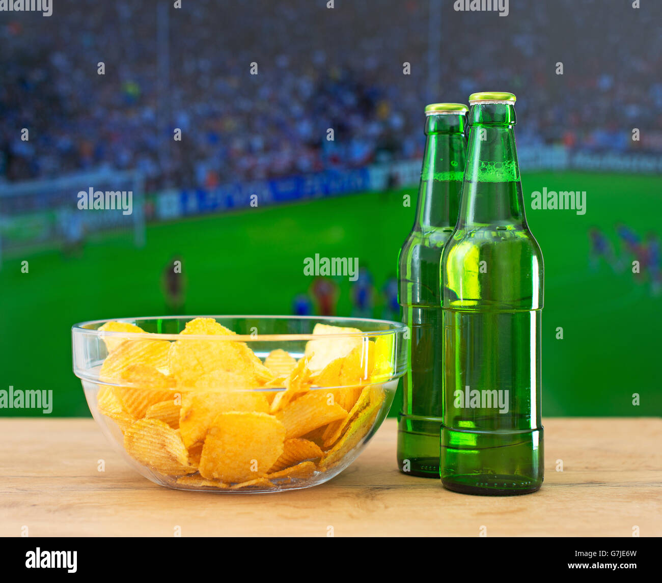 Beer and chips in front of TV with football match Stock ...