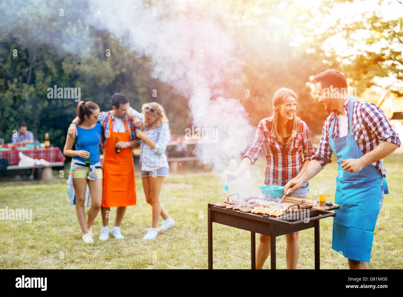 Friends having fun in nature doing bbq Stock Photo, Royalty Free ...