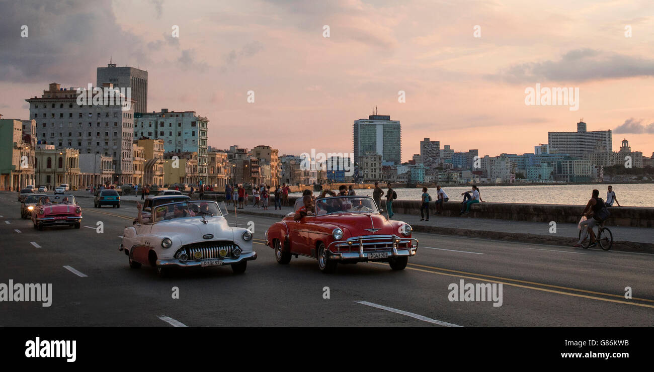 Classic cars driving along The Malecon (coast road) in Havana ...