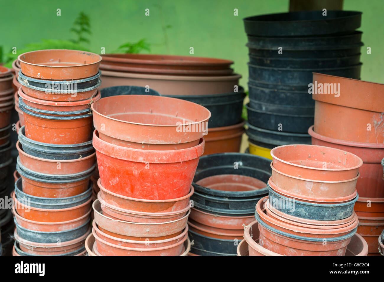 Plastic Plant Pots Part - 40: Empty Plastic Plant Pots Stacked On A Shelf In A Polytunnel.
