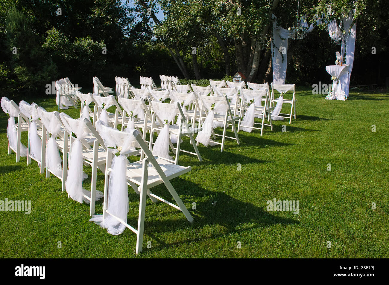 Wedding ceremony chair -  Arch For Wedding Ceremony White Decorated Chairs On A Green Lawn Chairs Set In