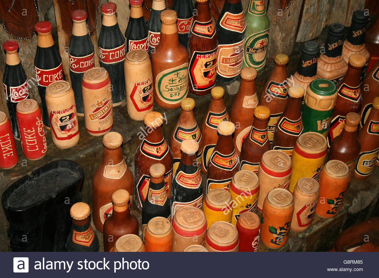 Ornamental bottles - Mozambique Flea Market Ornamental Soda Cans And Alcohol Bottles Carved From Wood For Sale In Ponta Do Ouro