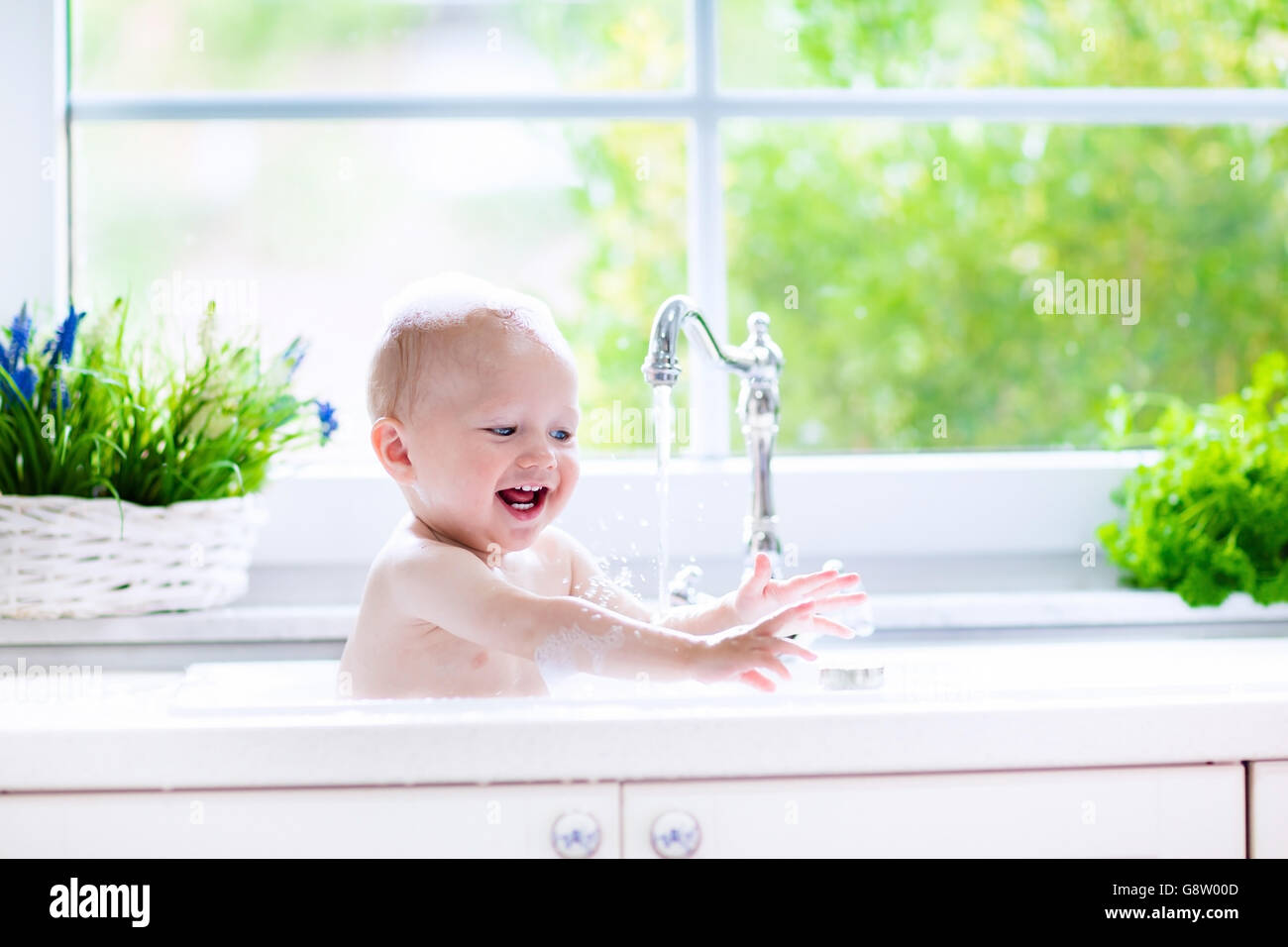 Baby Taking Bath In Kitchen Sink Child Playing With Foam