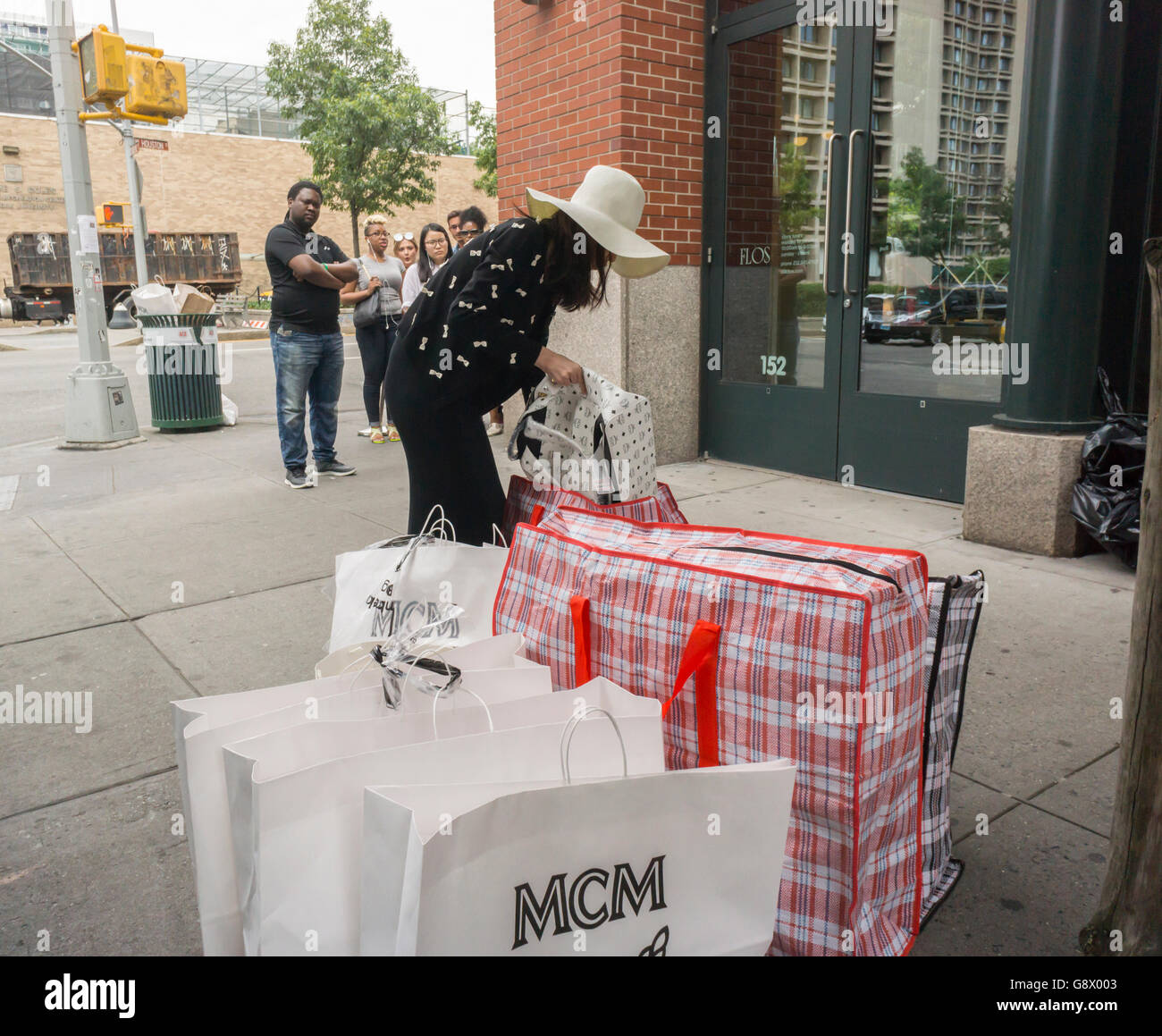 A shopper with her MCM purchases outside of their sample sale in ...
