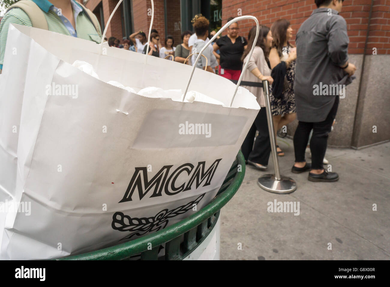 Fashion and budget conscious shoppers flock to the MCM sample sale ...