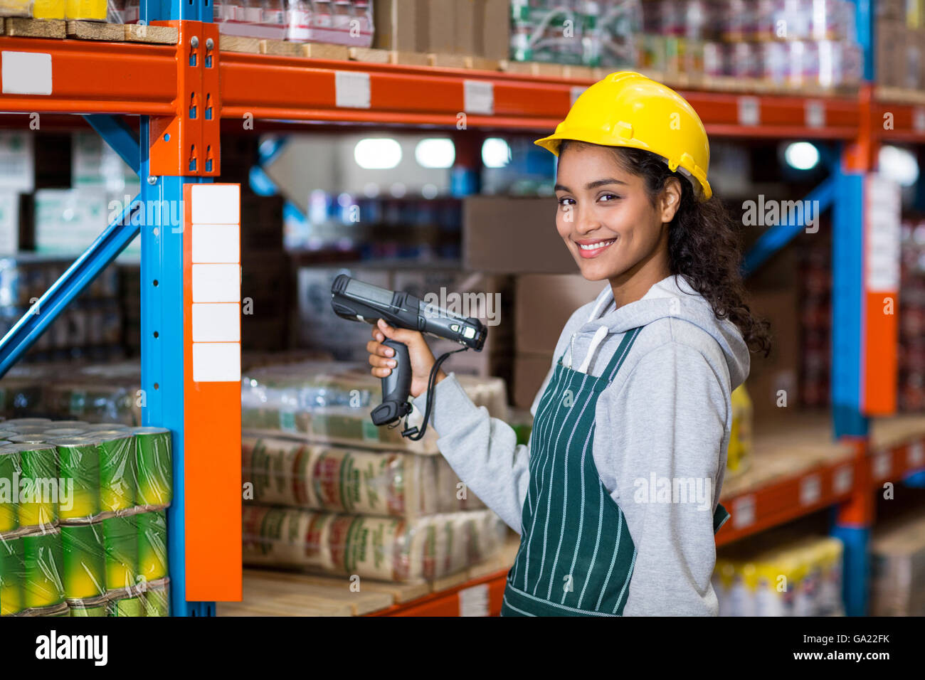 Female warehouse worker using digital equipment stock photo female warehouse worker using digital equipment sciox Choice Image