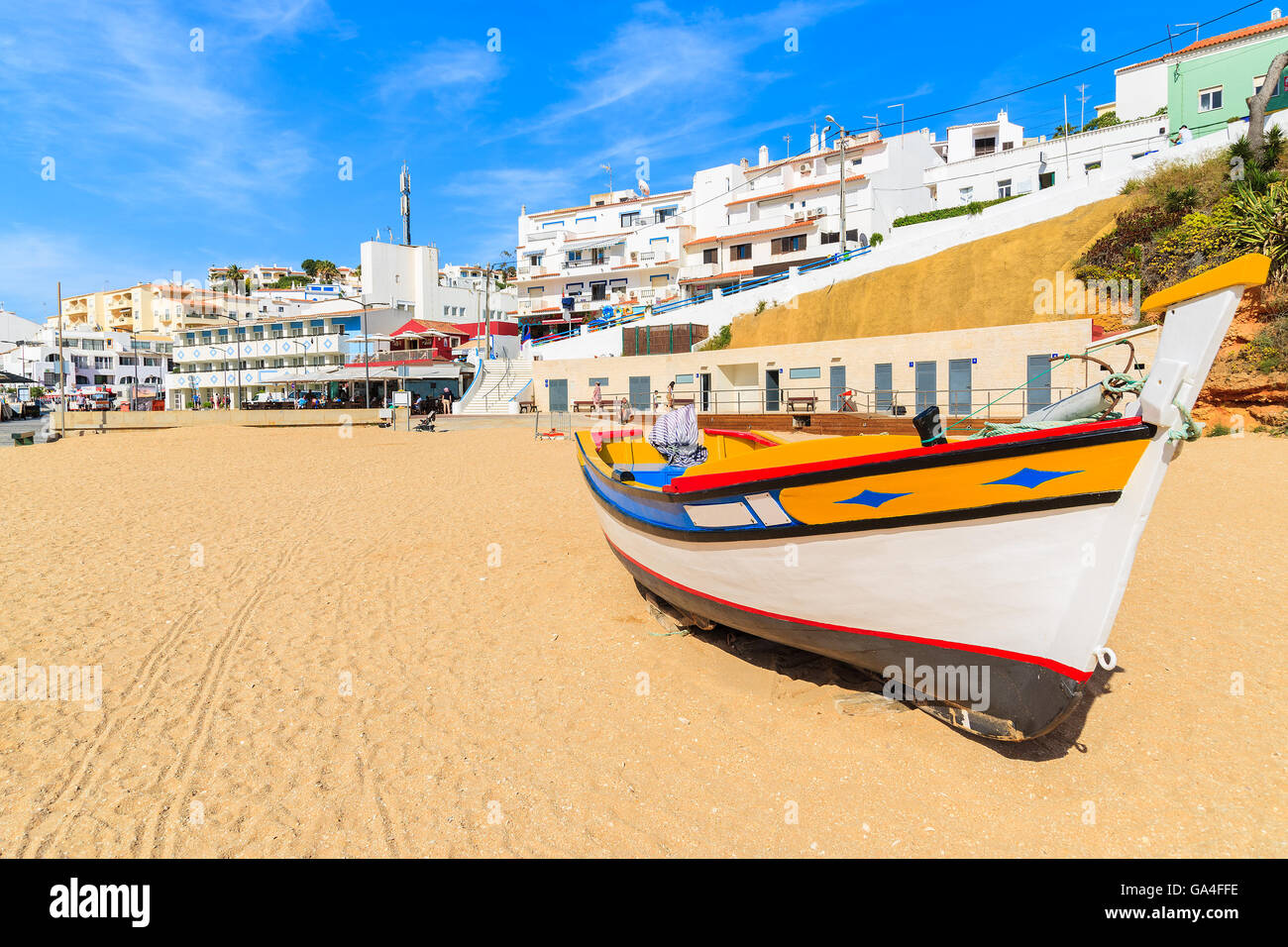 Typical colourful fishing boat on beach in Carvoeiro ...