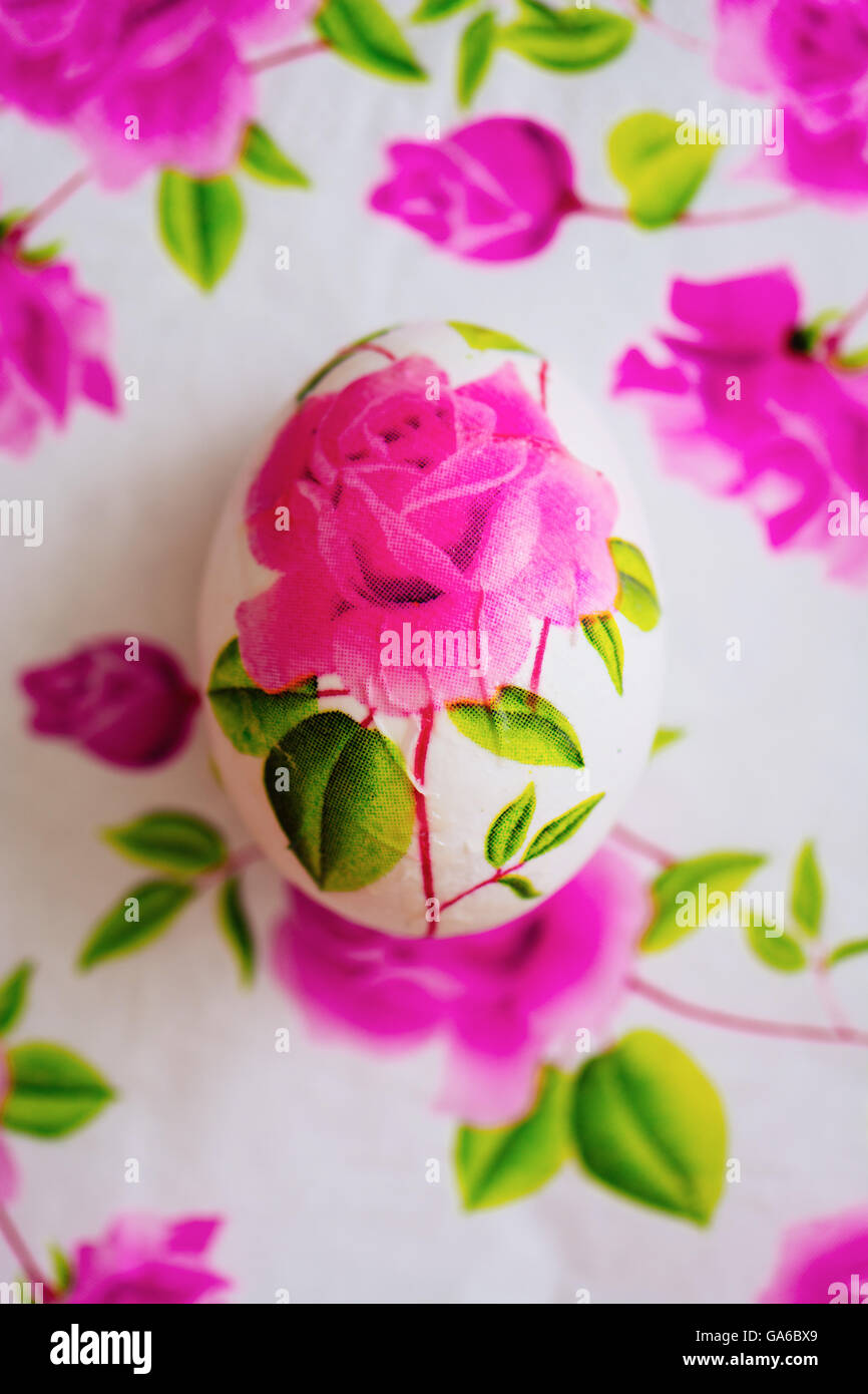 Decoupage easter egg decorated with flowered paper napkins and decoupage easter egg decorated with flowered paper napkins and stuck with glue above view mightylinksfo