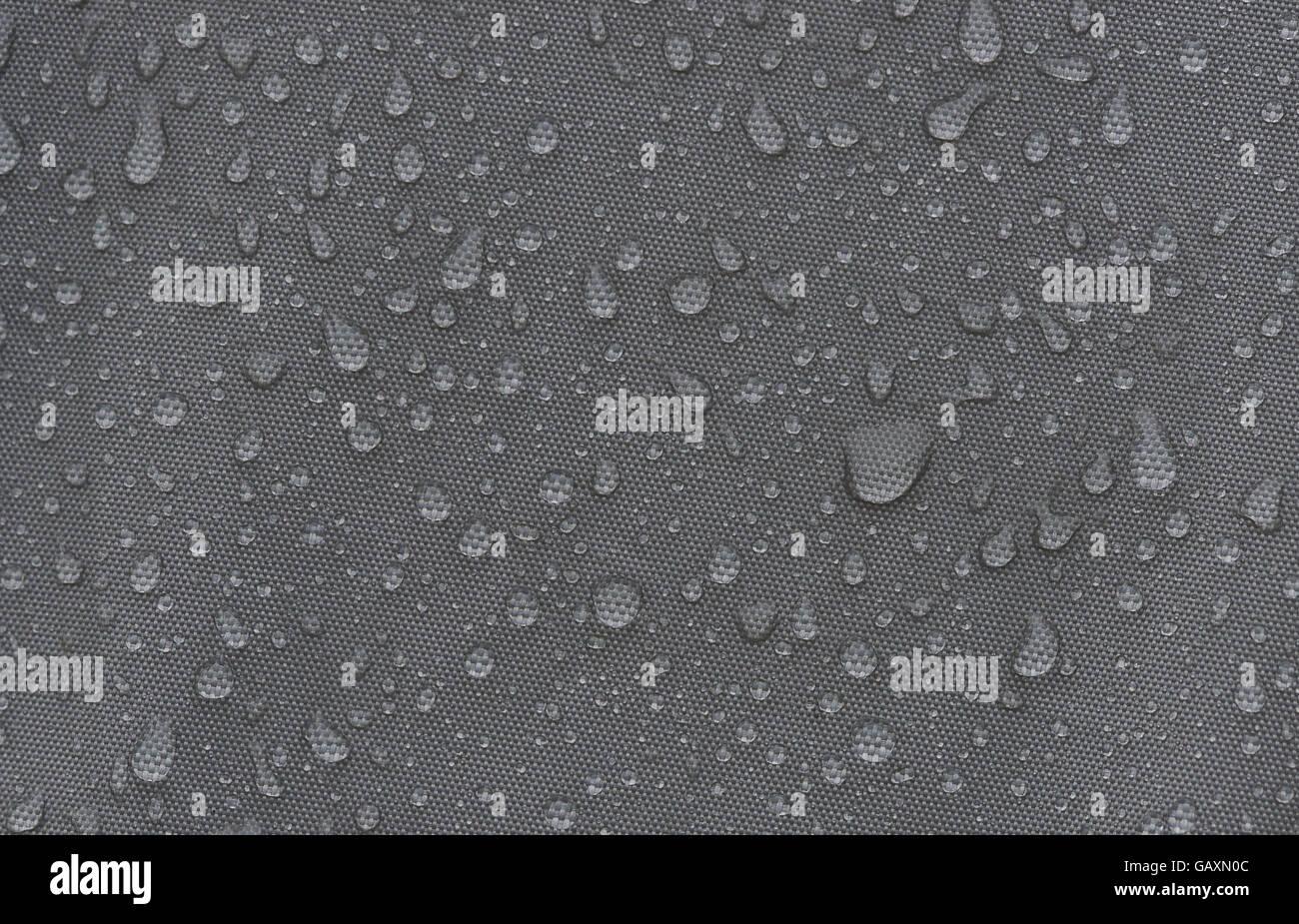 Rainproof tent sheet with rain drops. macro shot & Rainproof tent sheet with rain drops. macro shot Stock Photo ...