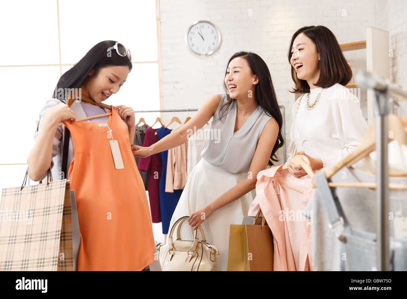 Young women's clothing store shopping in bestie Stock Photo ...
