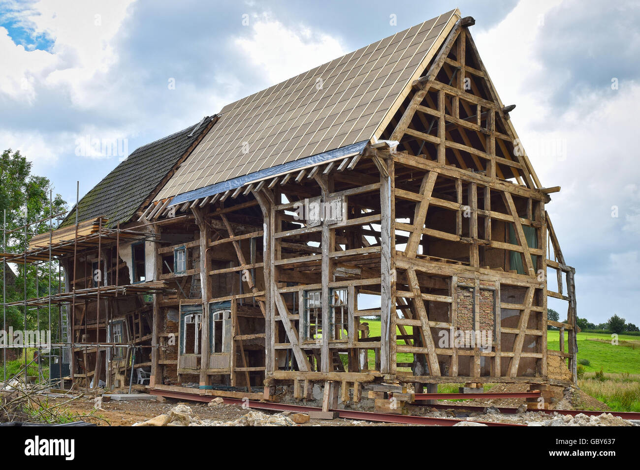 House Reconstruction timber frame of a half-timbered house under reconstruction stock