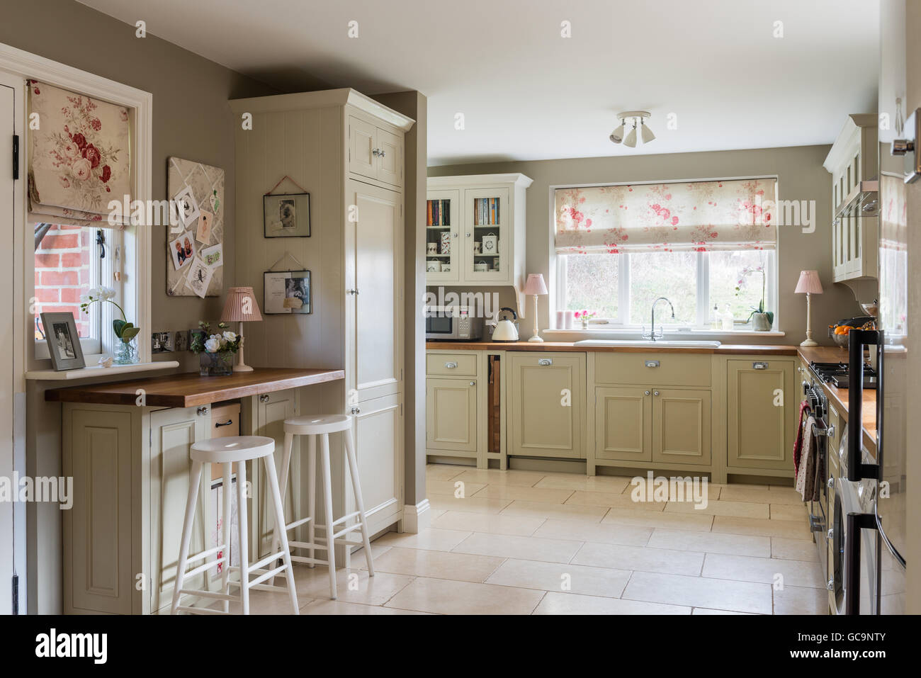 Country style kitchen with units from neptune and tumbled country style kitchen with units from neptune and tumbled limestone floor tiles the roman blind is made up in kate formas rose dailygadgetfo Choice Image