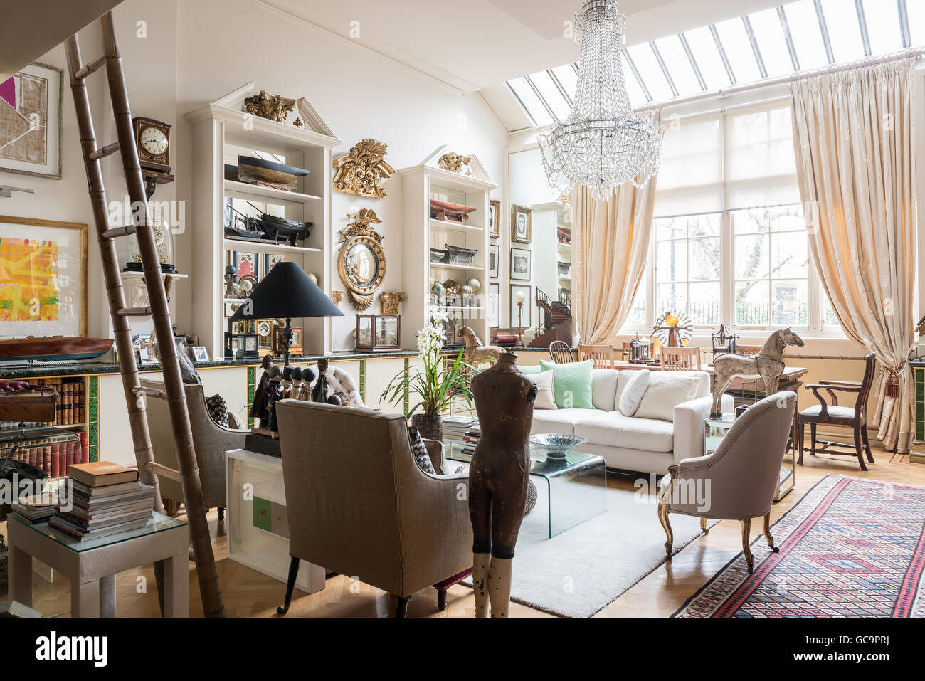 1920s chandelier in drawing room of london apartment filled with 1920s chandelier in drawing room of london apartment filled with antique collectables uk arubaitofo Gallery