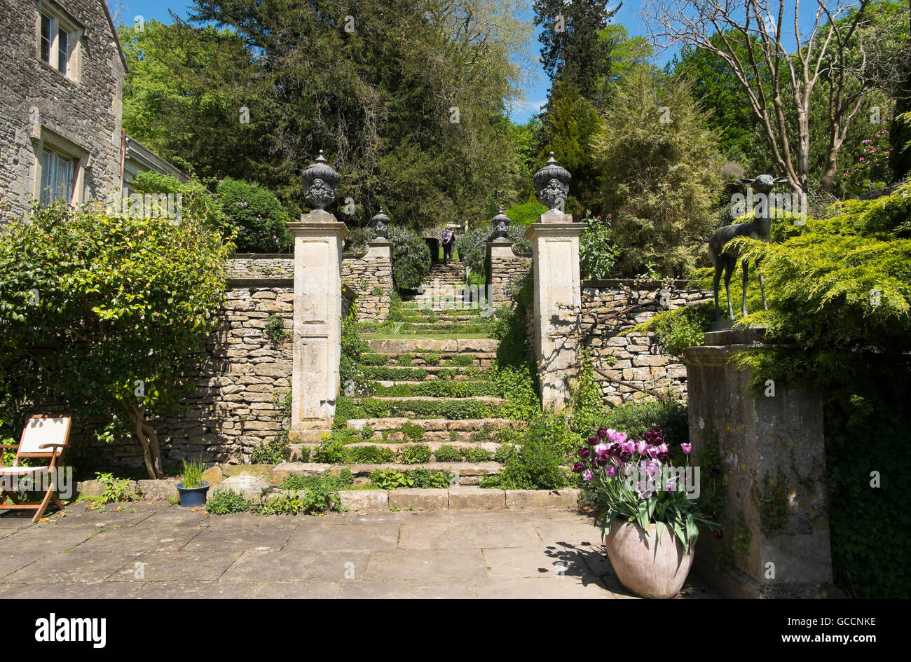 Steps up from the paved courtyard outside the Loggia at The Peto ...