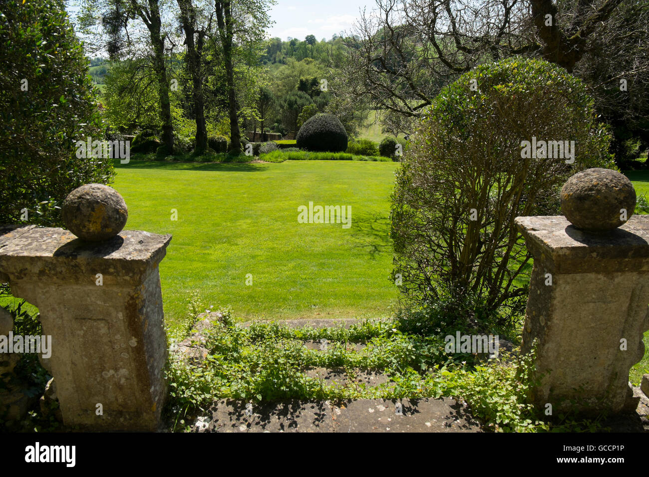 View across the grass lawn from the Garden House at The Peto Garden ...