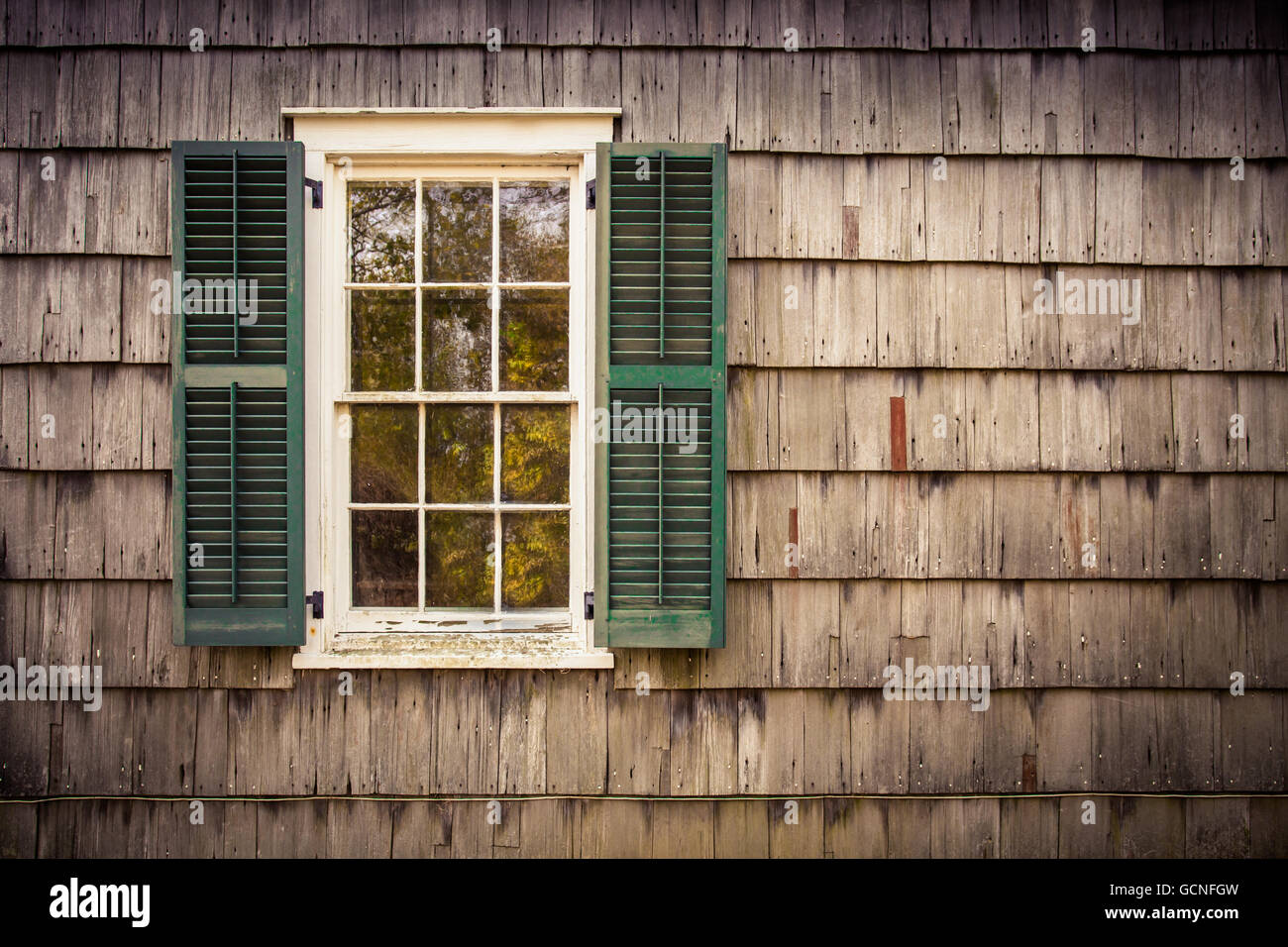 details on home exterior with window, shutters and wooden cedar ...