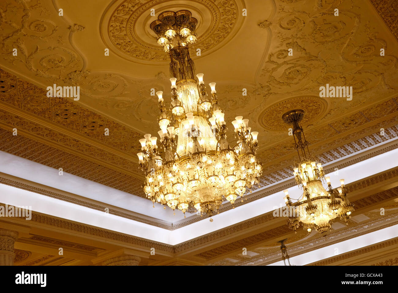 Elegant crystal chandeliers of the palace of the parliament elegant crystal chandeliers of the palace of the parliament palatul parlamentului in bucharest romania arubaitofo Choice Image