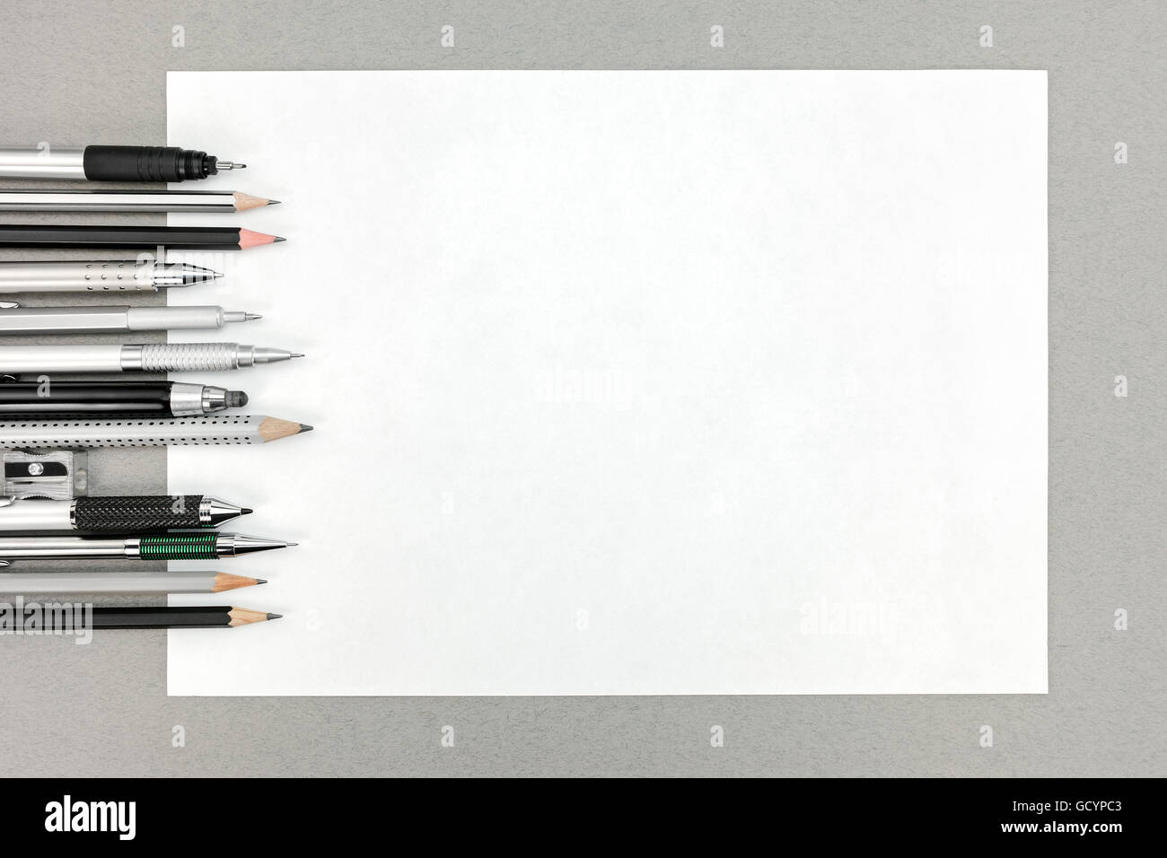 office drawing tools. stock photo various drawing tools and blank sheet of paper on gray office desk table r