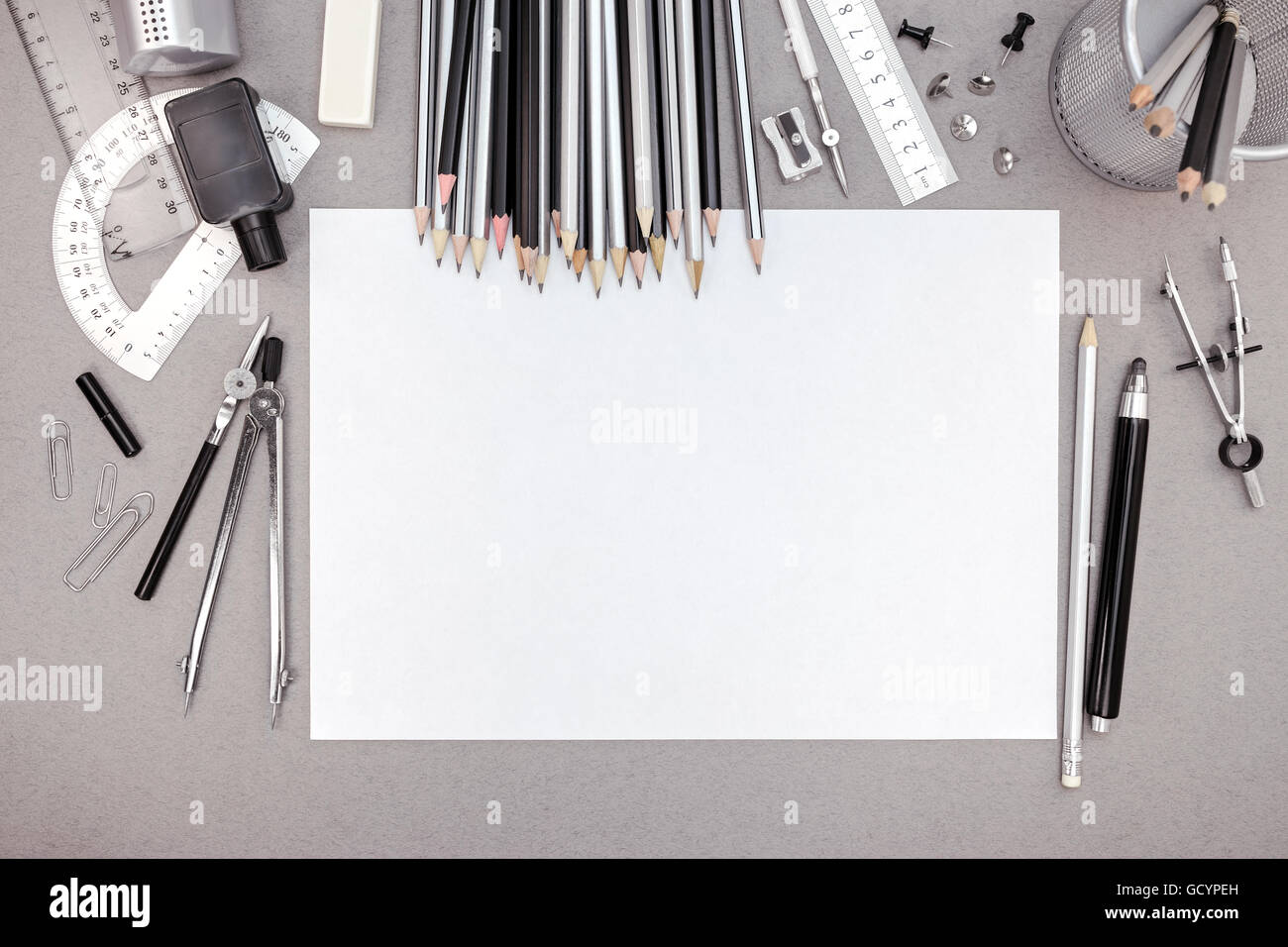 office drawing tools. stock photo office workspace with blank paper pencils and various drawing tools top view i