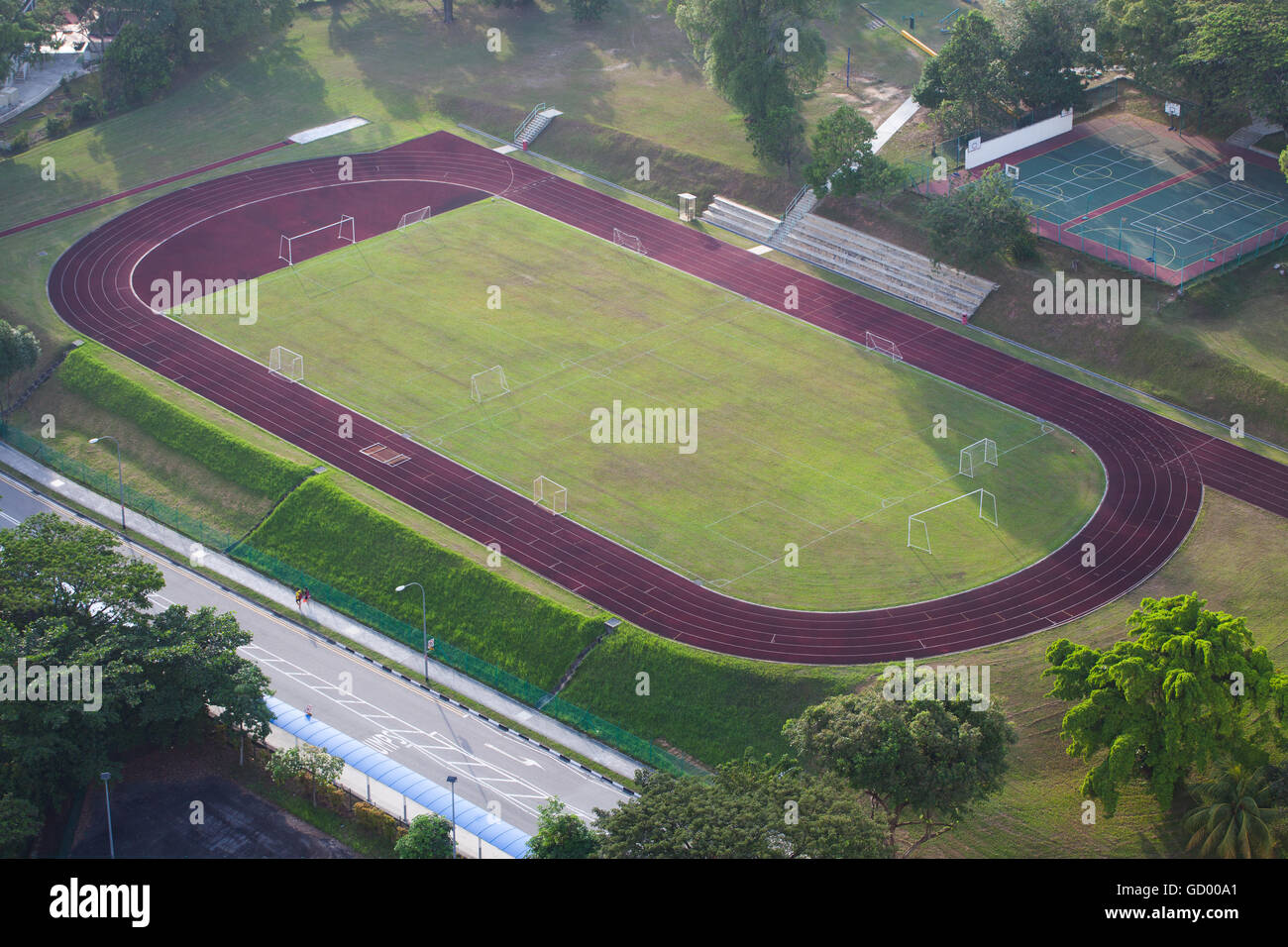 Aerial view of a football field, tennis court and running ...  |Running Track Birds Eye View