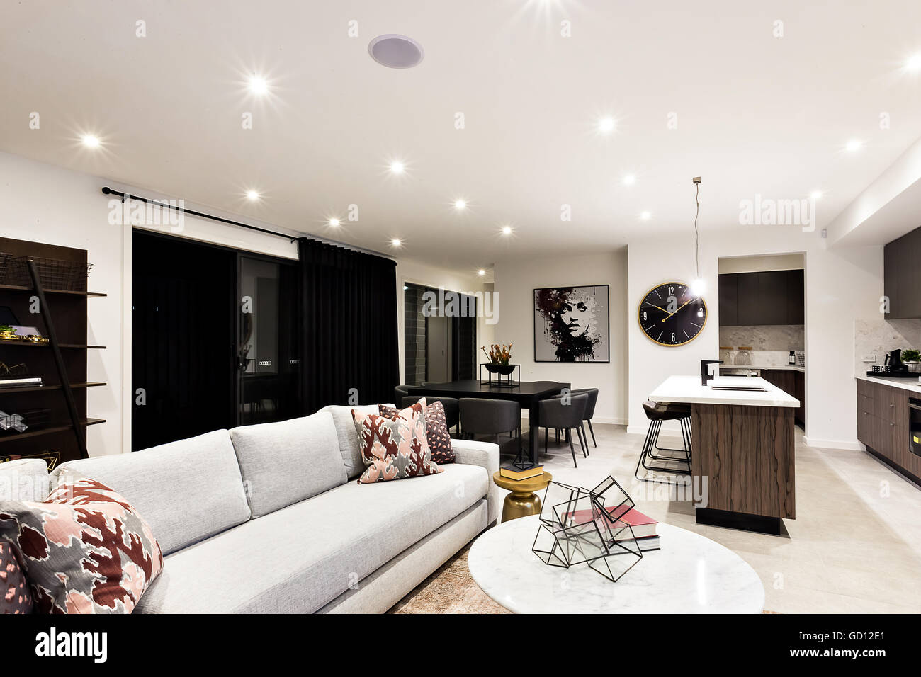 Luxury Living Room With Sofas And Pillows Beside Kitchen Counter Top Dining Table