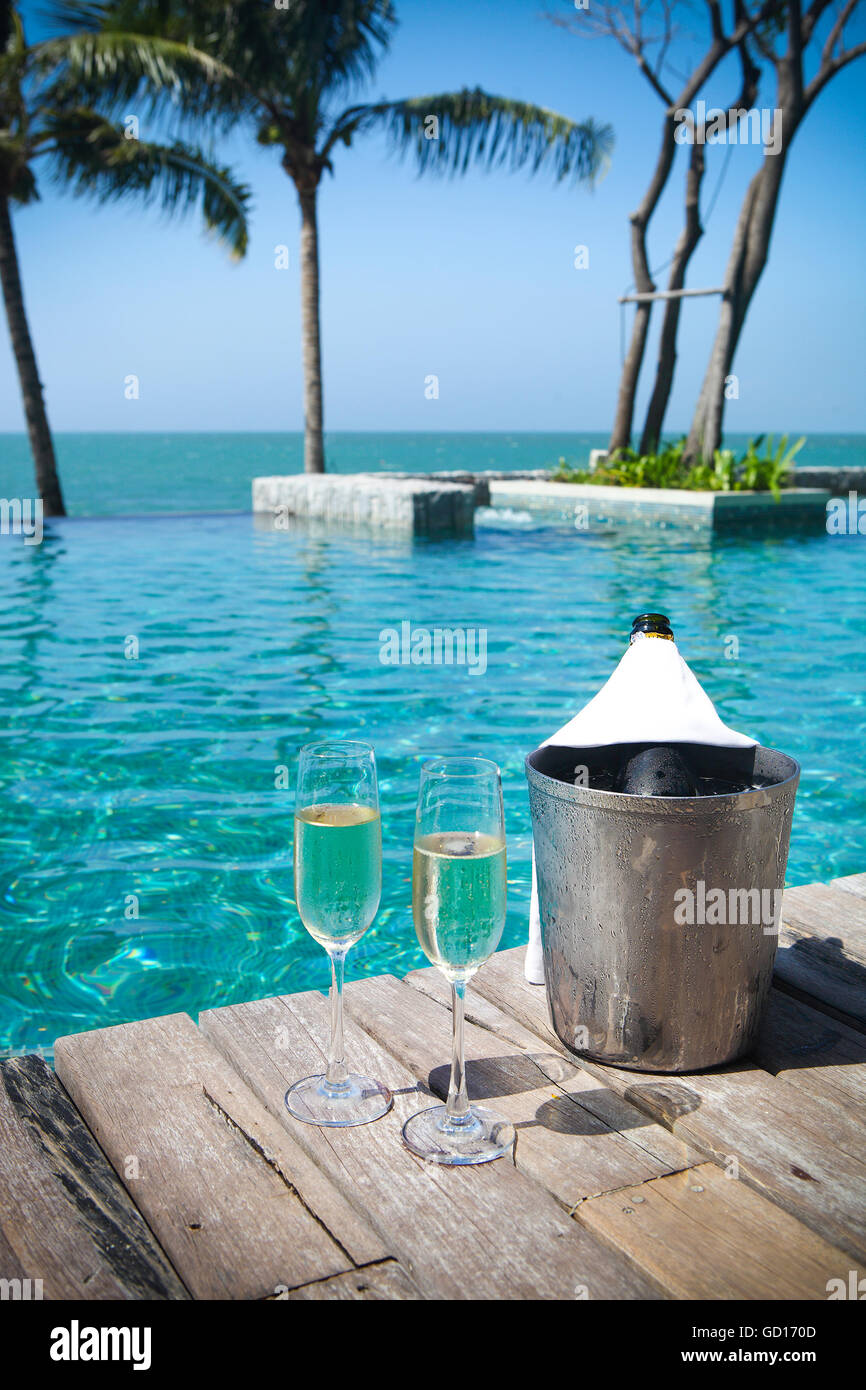 Champagne Bottle In Ice Bucket And Champagne Glasses By