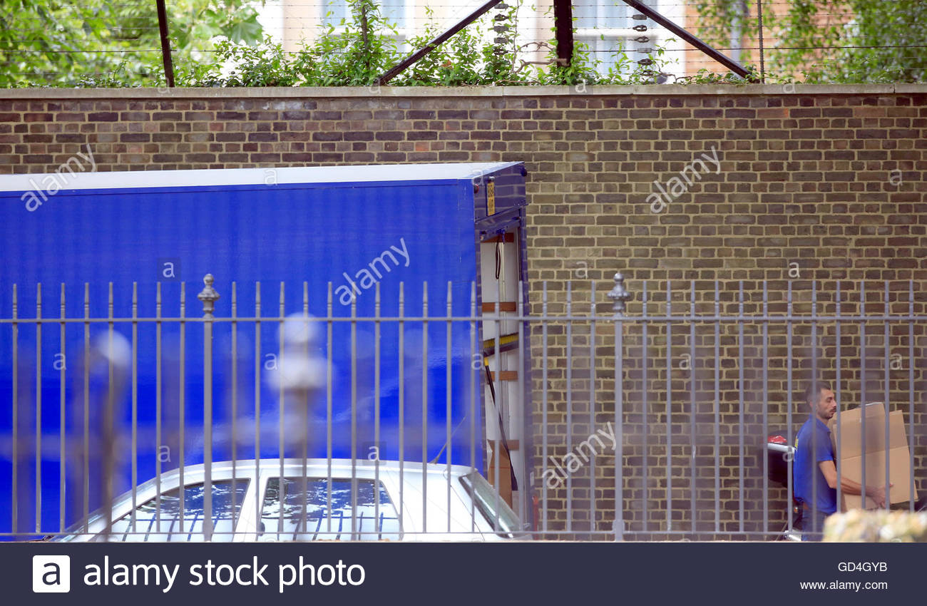 A Furniture Removal Lorry Is Seen Parked At The Rear Of Number 10
