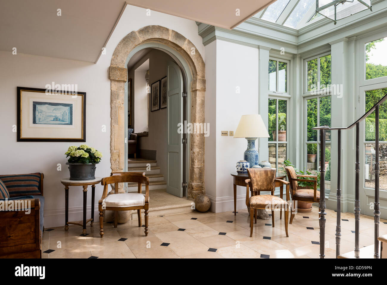 Old Leather Bridge Chairs And Round Table In Entrance Hall With Stone Arch  And Glass Ceiling