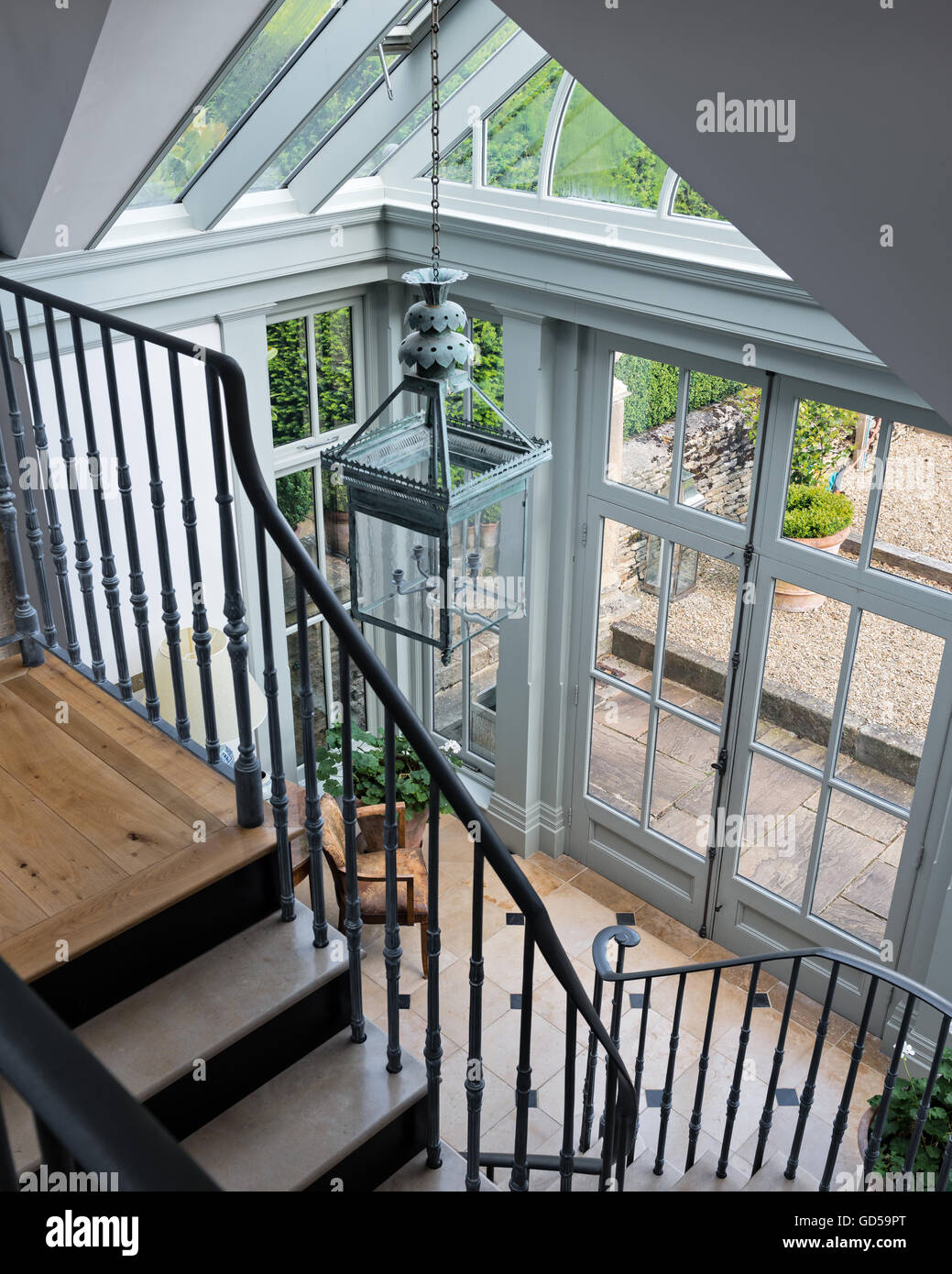 Stock Photo   Stone And Metal Staircase In Entrance Hall With Glass Panelled  Ceiling And Hanging Lantern